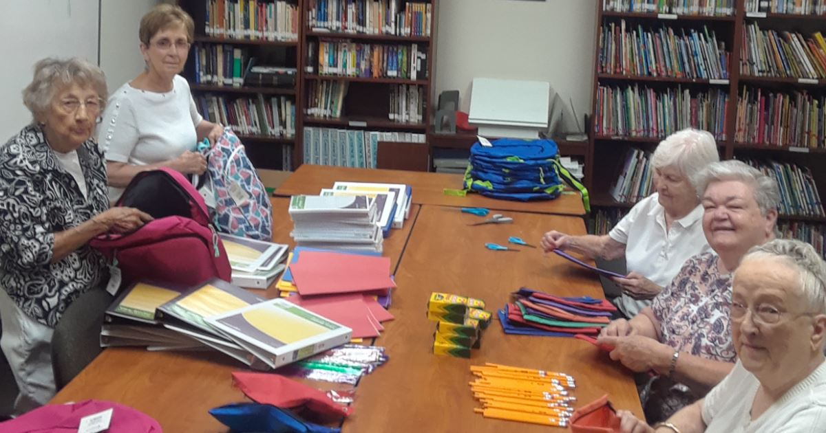 Women's Fellowship packing school supplies