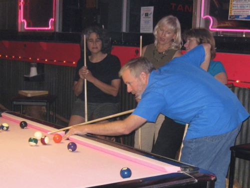 Shooting pool at Pink Galleon